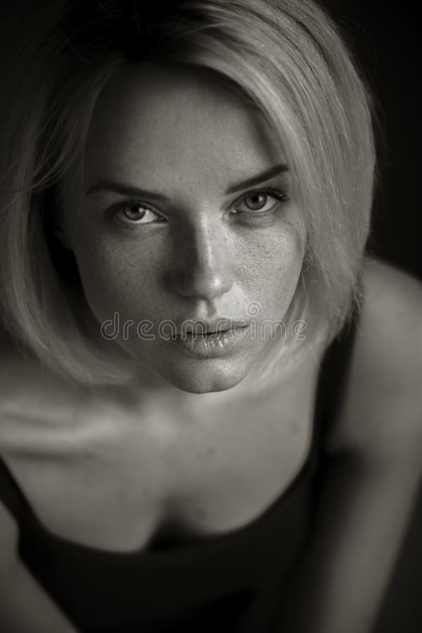 Blonde woman is looking at camera royalty free stock photo