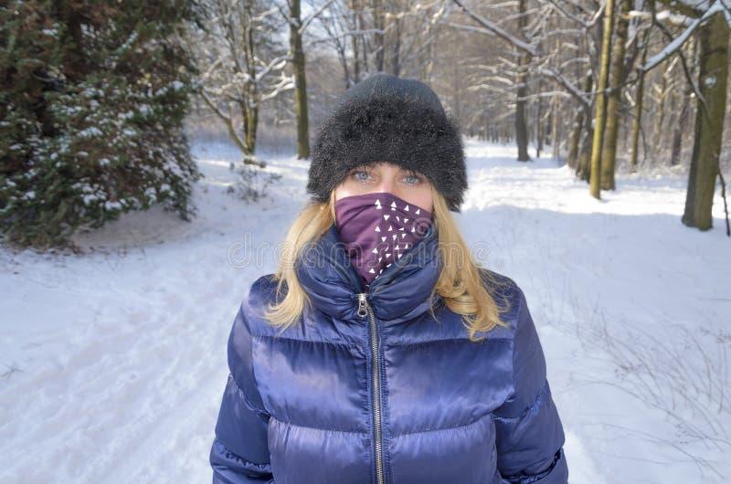 A woman portrait en face in the winter landscape royalty free stock photo