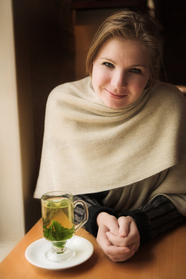 Blonde woman with mint tea royalty free stock image