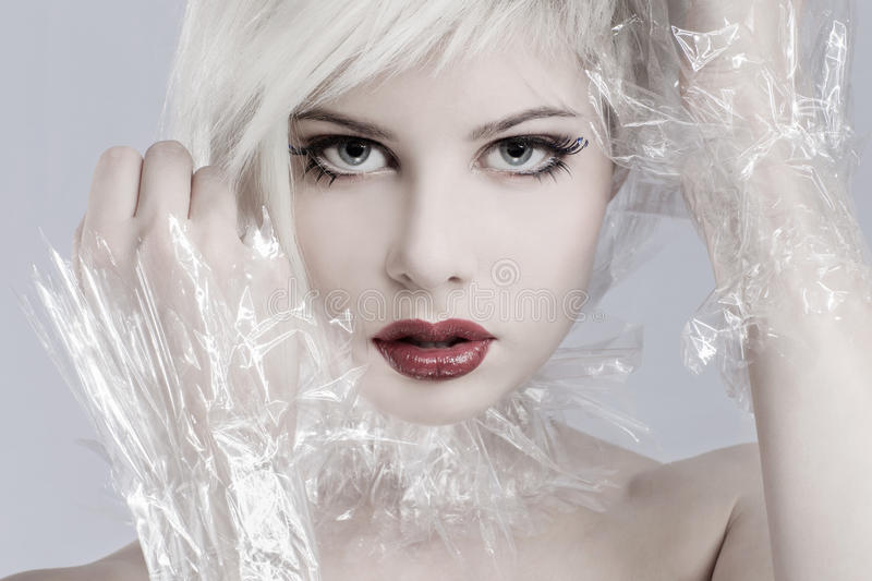 Blonde woman model in plastic stock images