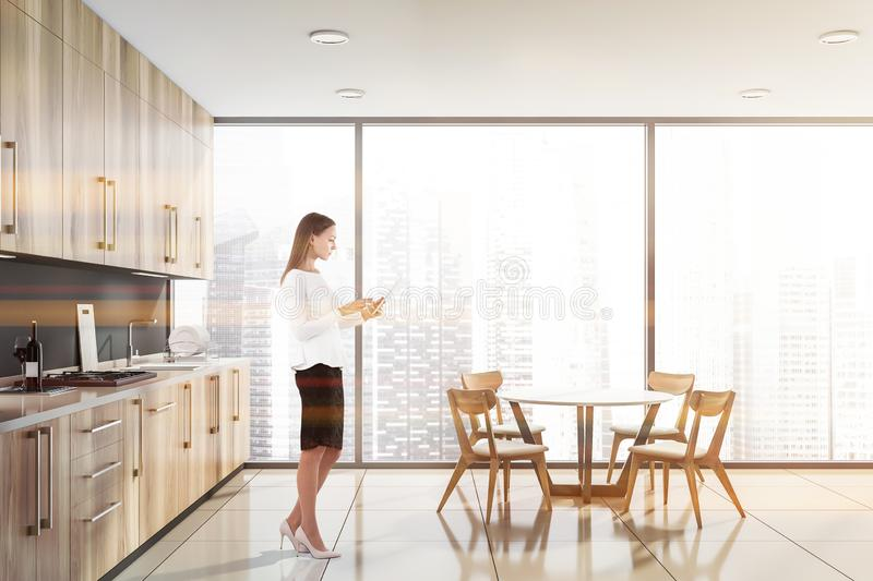 Blonde woman in panoramic kitchen stock photos