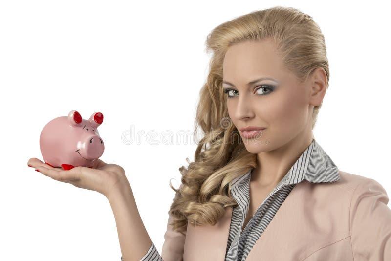 Blonde woman with piggybank royalty free stock photo