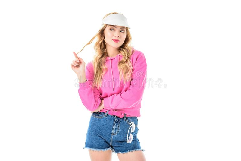 Blonde woman in pink clothes playing with hair royalty free stock photo