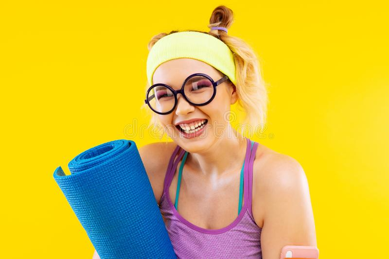 Blonde woman with pink eye shades laughing before sport royalty free stock images