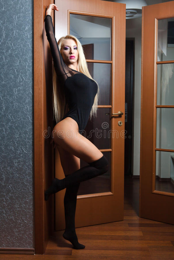 Blonde woman posing in doorway royalty free stock photos