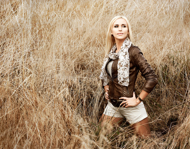 Blonde Woman Posing at the Field. Rear View stock image