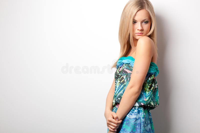 Blonde woman posing near wall royalty free stock photography
