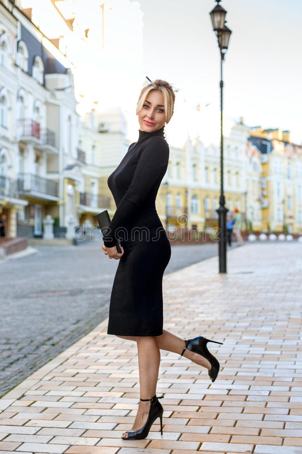 Blonde woman posing outdoor on the street stock images