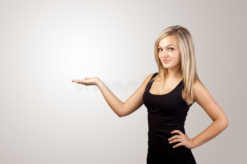Blonde woman presenting hand royalty free stock photography