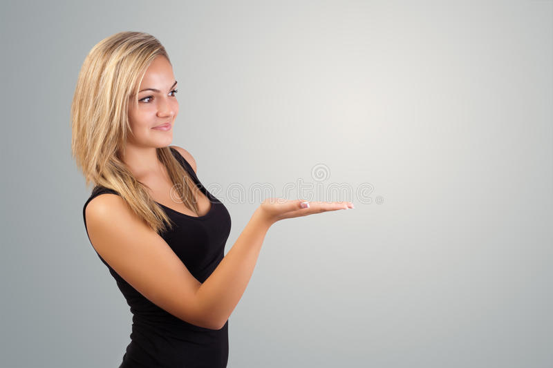 Blonde woman presenting hand stock image
