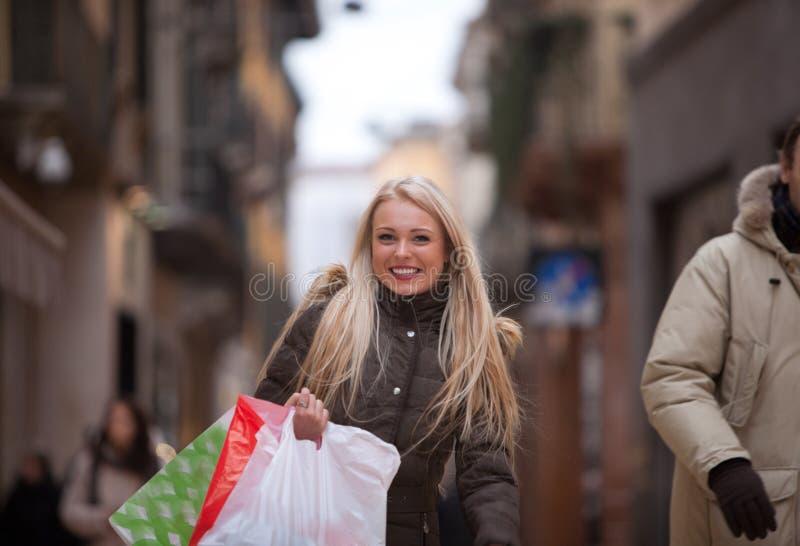 Blonde woman shopping touring in Europe royalty free stock photos
