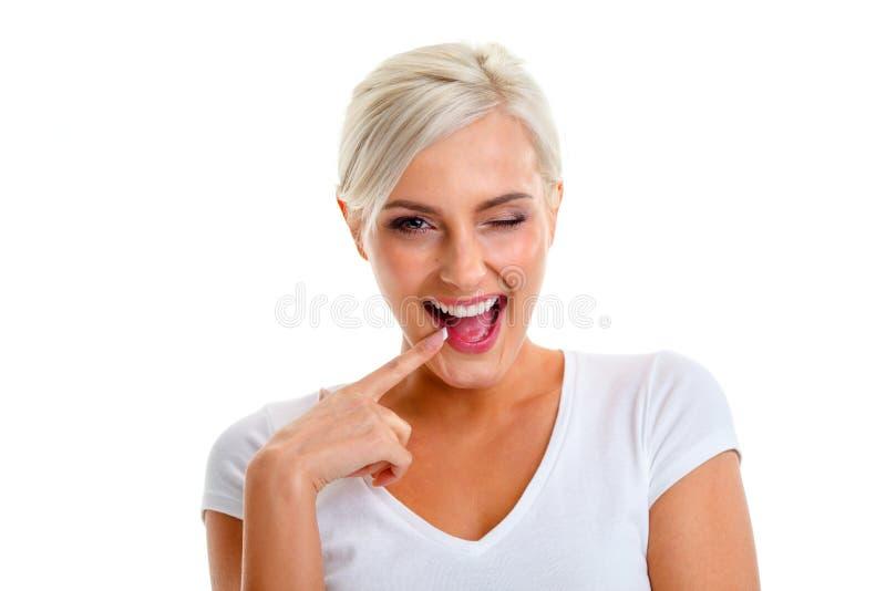 Blonde woman showing emotions. Beautiful blonde positive woman showing emotions, isolated stock photos