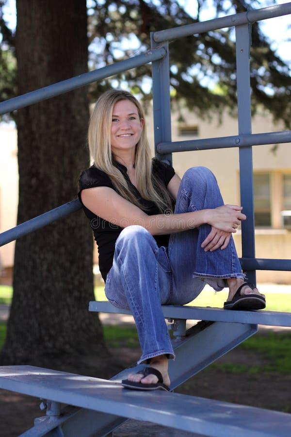 Free Blonde Woman Sitting In Bleachers Royalty Free Stock Photo - 11459675