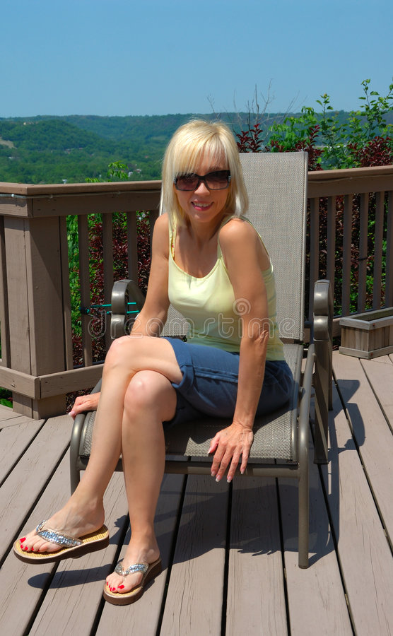 Blonde Woman Sitting Outdoors royalty free stock photo