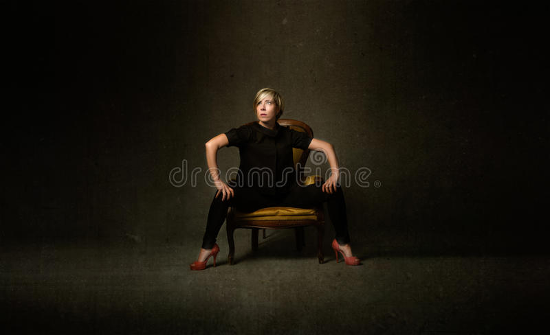 Blonde woman sitting royalty free stock photography
