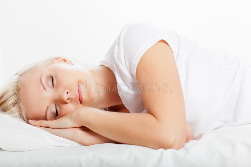 Blonde woman sleeping royalty free stock image