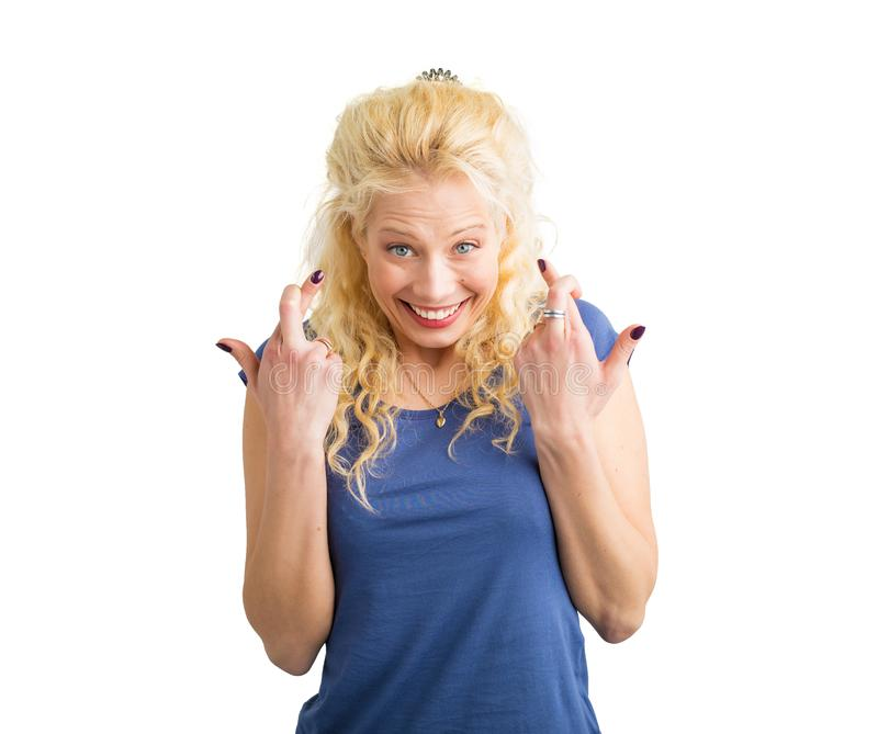 Woman standing with her fingers crossed stock image