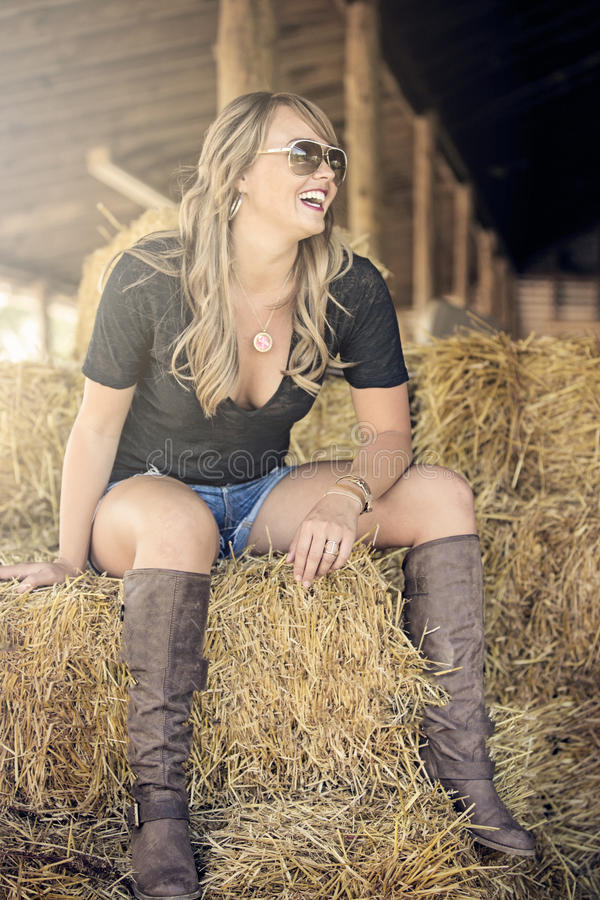 Download Blonde woman on straw bale stock photo. Image of woman - 34298446
