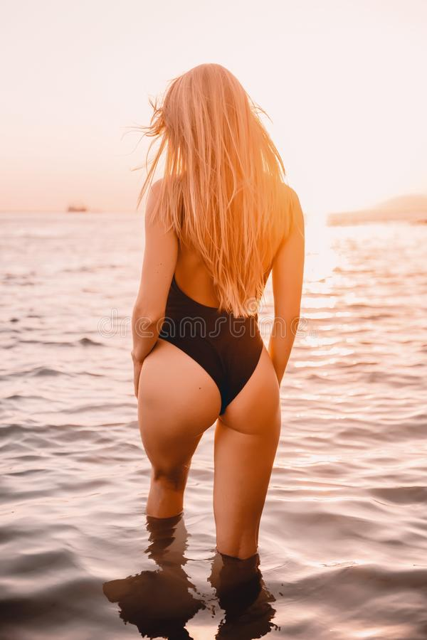 Blonde woman in swimwear bikini with perfect body. royalty free stock photos