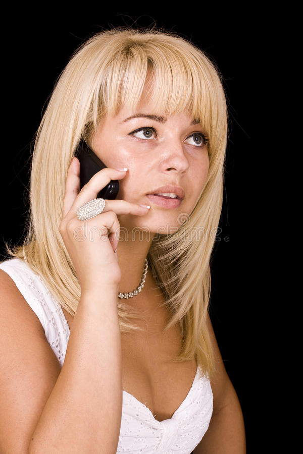Blonde woman talking stock photography