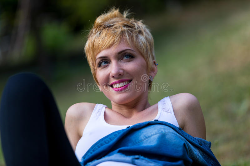 Blonde woman thinking outdoors portrait royalty free stock images