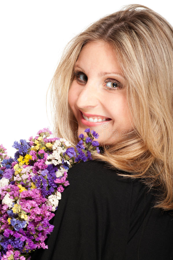 Blonde woman turning with bouquet stock photo