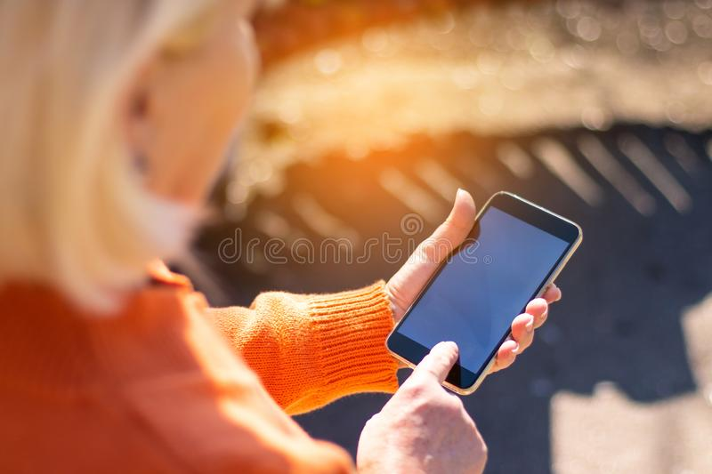 Blonde woman using social networks stock photography