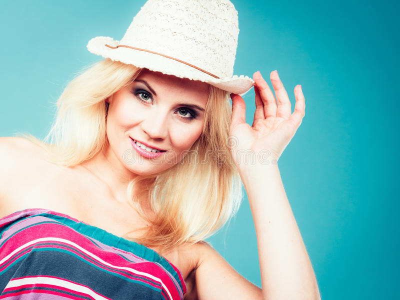 Blonde woman wearing colorful striped strapless shirt. Summer trendy fashionable outfit ideas concept. Blonde woman wearing colorful striped strapless shirt and stock photography