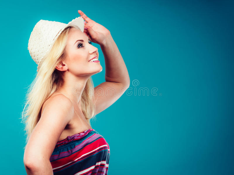Blonde woman wearing colorful striped strapless shirt. Summer trendy fashionable outfit ideas concept. Blonde woman wearing colorful striped strapless shirt and royalty free stock image