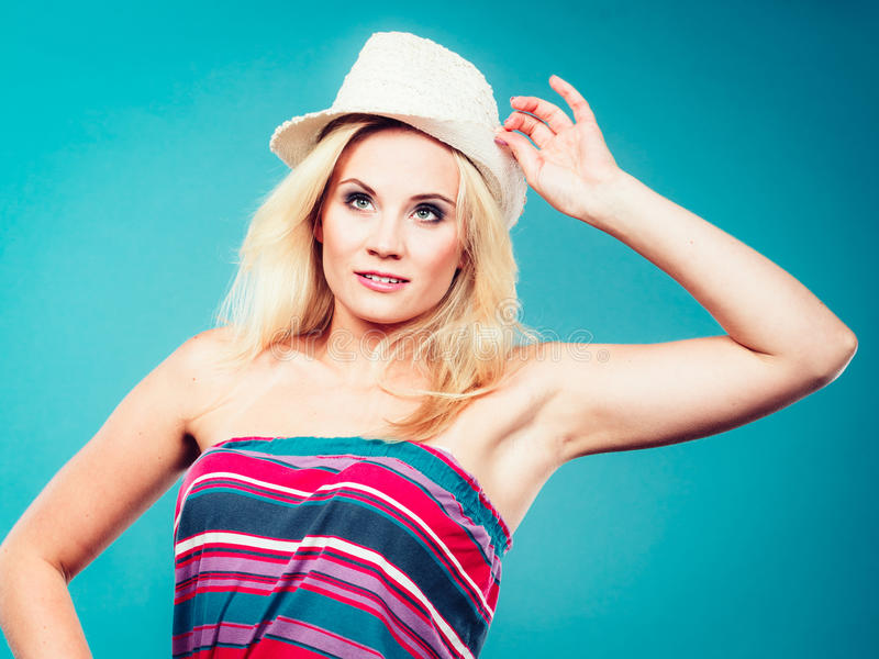 Blonde woman wearing colorful striped strapless shirt. Summer trendy fashionable outfit ideas concept. Blonde woman wearing colorful striped strapless shirt and stock images