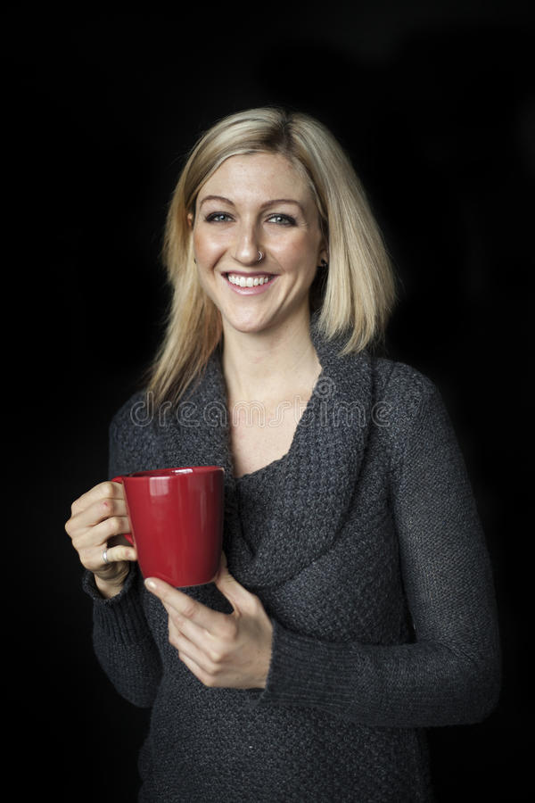 Free Blonde Woman With Beautiful Blue Eyes And Red Coffee Cup. Stock Photography - 36372972