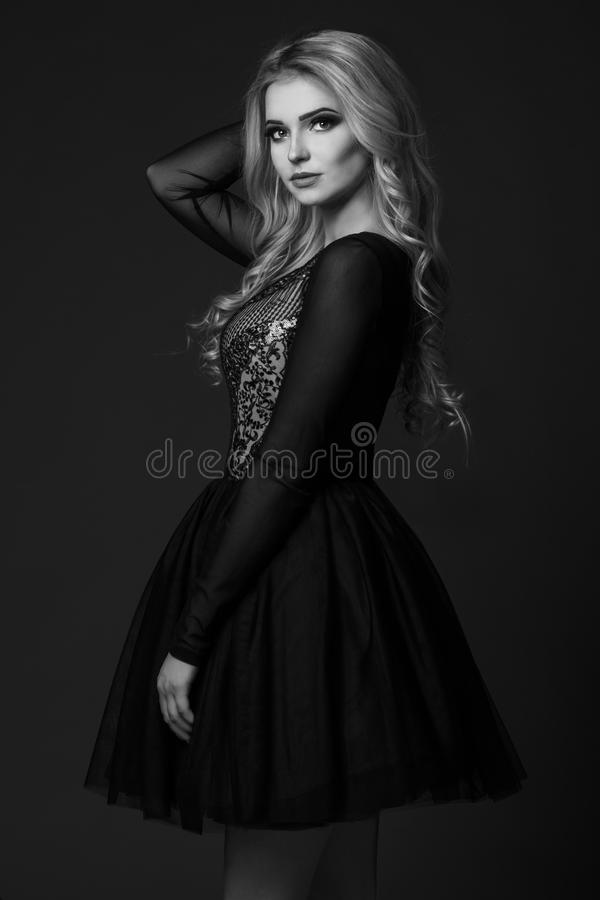 Blonde women in black and white. Blonde woman in black and white royalty free stock photo