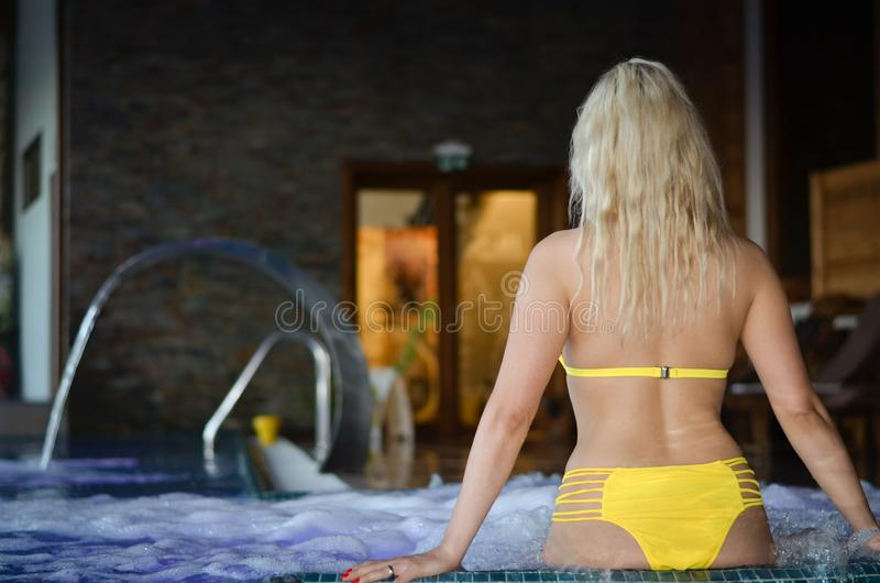 Blonde women  girl relaxing  in jacuzzi hot tub  durig vacation stock images