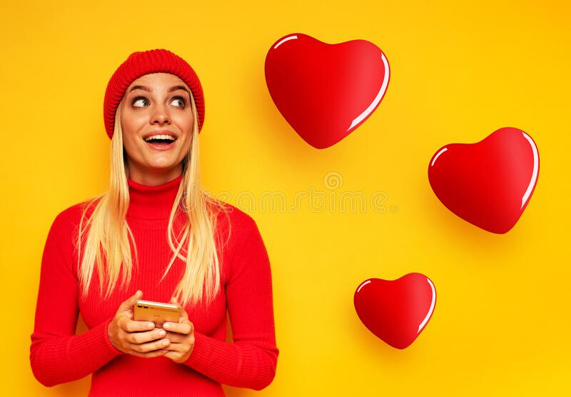 Blonde young girl chats with people. Concept of relationship, meeting on social network royalty free stock photography