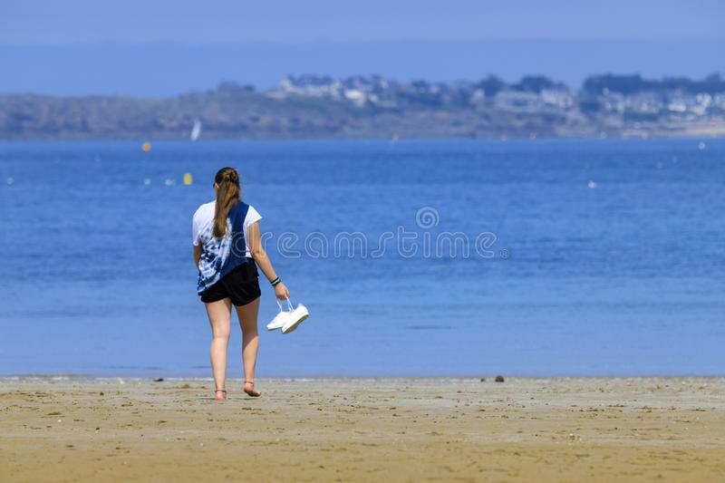 Blonde young girl on the seashore stock photos