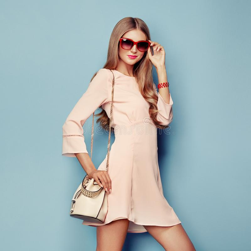 Blonde young woman in coral spring summer dress stock photos