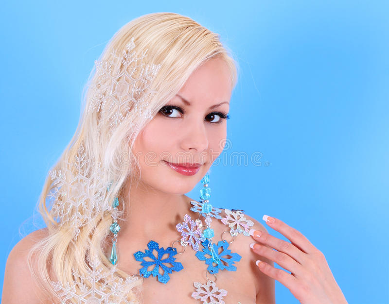 Download Blonde Young Woman Decorated With Snowflakes Over Blue Stock Photo - Image: 28108712