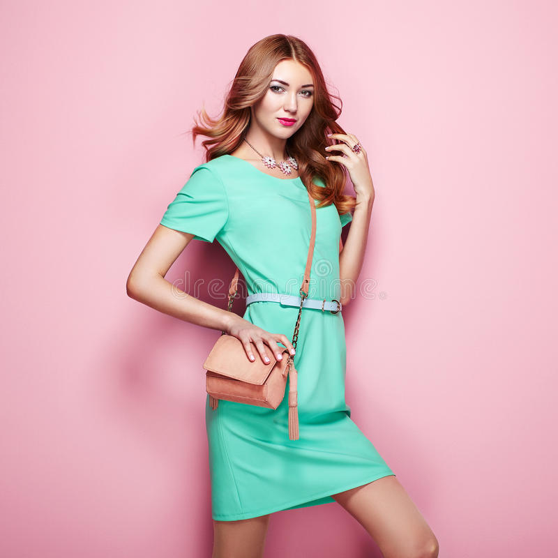 Blonde young woman in elegant green dress stock photos
