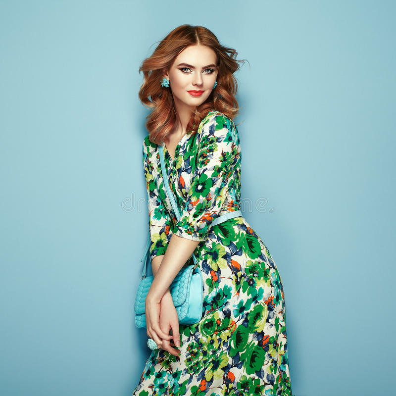 Blonde young woman in floral spring summer dress stock image
