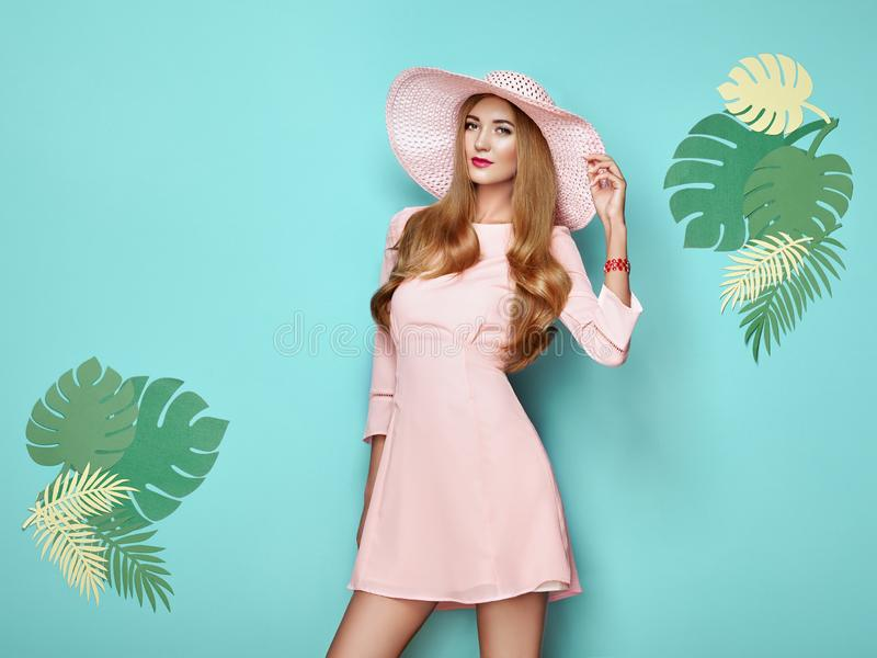 Blonde young woman in floral spring summer dress stock photography
