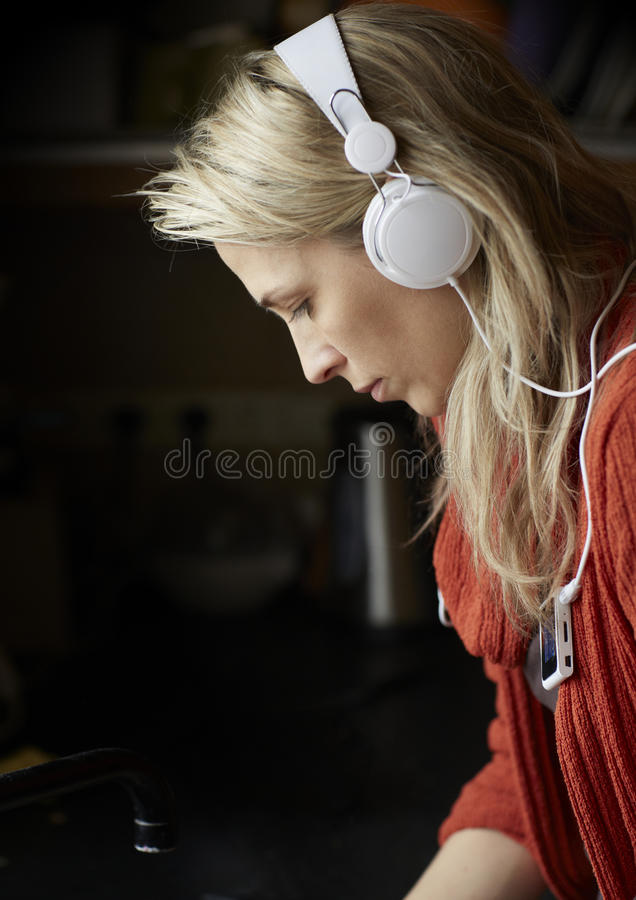 Download Blonde Young Woman Listens Music By Headphones Stock Photo - Image: 28980824