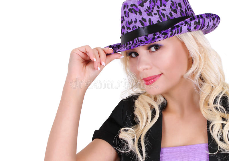 Blonde young woman with purple leopard print hat. Blonde young woman wearing purple leopard print hat, isolated on white, party girl royalty free stock photo