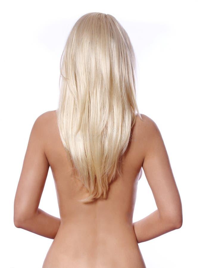Blondes Haar, Rückseite der jungen Frau mit dem geraden blonden Haar lokalisiert stockfotografie