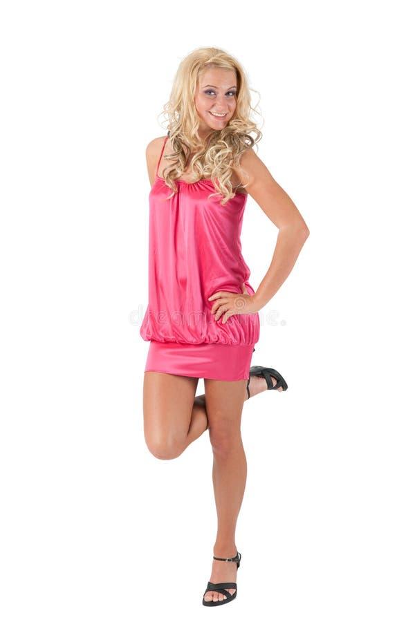 Blondes Mädchen, das auf einem Fuß steht lizenzfreie stockfotografie