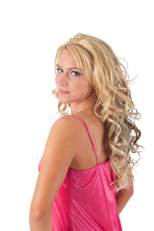 Blondes Mädchen im rosafarbenen Kittel lizenzfreie stockfotografie