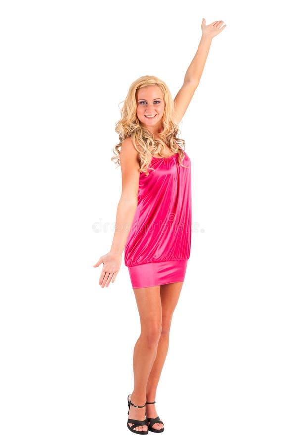 Blondes Mädchen mit dem Arm angehoben worden lizenzfreies stockbild