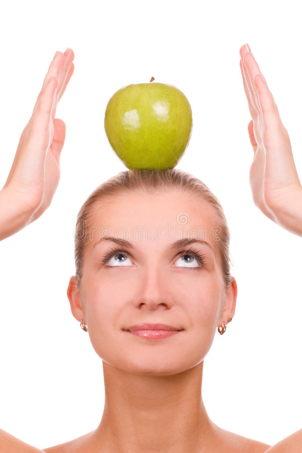 Blondes Mädchen mit einem Apfel lizenzfreie stockbilder