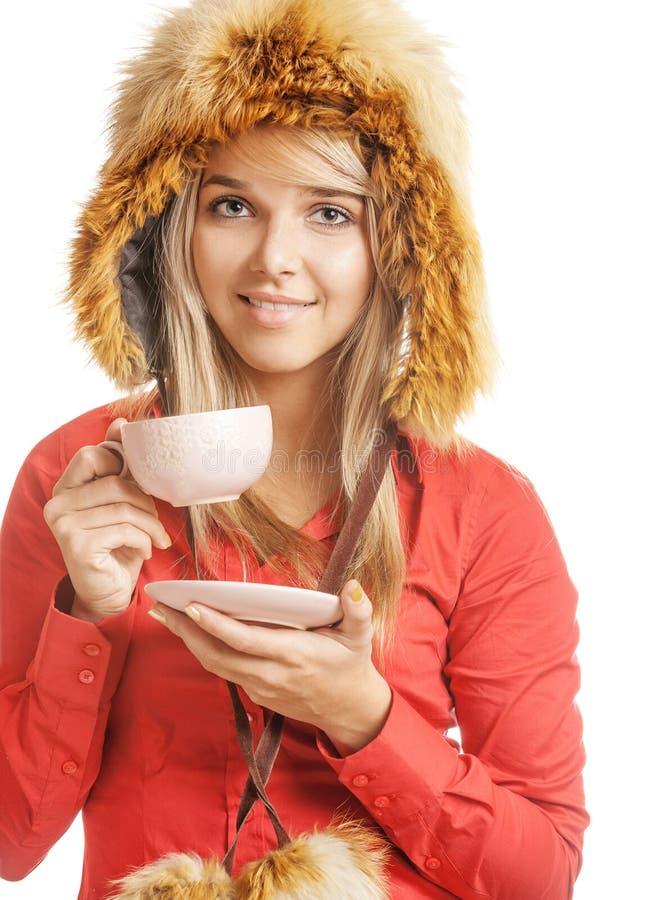 blondinen dricker varm tea royaltyfri fotografi