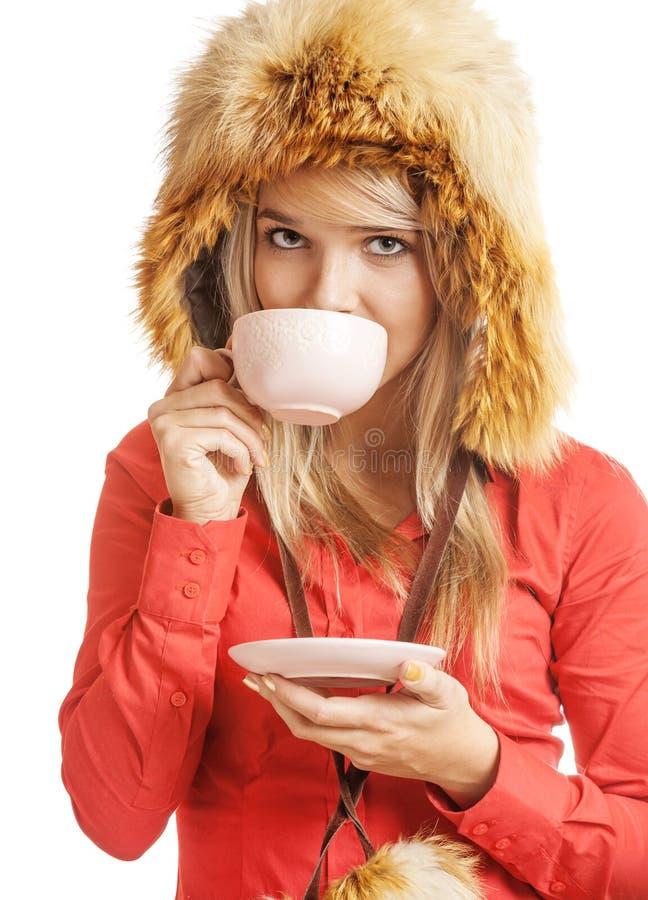 blondinen dricker varm tea fotografering för bildbyråer