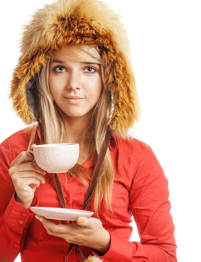 blondinen dricker varm tea arkivfoto